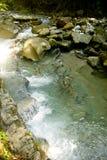 Sun una inmersión rápida en las montañas Imagenes de archivo
