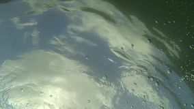Sun under water stock footage