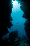 Sun, Underwater Crevice and Snorkelers Royalty Free Stock Images