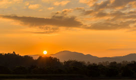 Sun Up. The sun comes up from behind the mountains in North Thailand Royalty Free Stock Photo