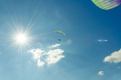 Sun view with two paragliders in the blue sky Royalty Free Stock Images