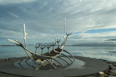 Sun Voyager. Beautiful sunrise in Reykjavik in July. A popular stop where tourists take pictures with this monument describing the look of the Viking´s ship Royalty Free Stock Image
