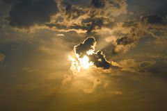 The sun was hidden behind the clouds royalty free stock image