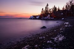 Sunset at Hollow Rock. The sun was setting on another winter day along Lake Superior Stock Image
