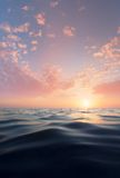 Sun and water. A calm sea on a beautiful sunset background Stock Image