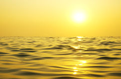 Sun and water. Early morning sunrise over the sea Stock Photography