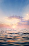 Sun and water. Suunrise photographed during in the sea Stock Image