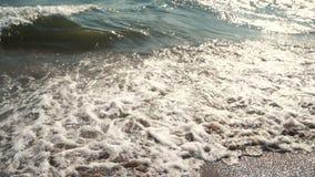 Sun waves on sea surface. Sun reflection on sea surface on sunset stock footage