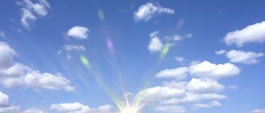 Sun, white clouds and blue sky. Rainbow beams Stock Photography