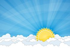 Sun and white clouds over blue sky Stock Photo
