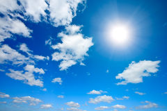 Sun and white clouds in sky Royalty Free Stock Image