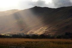 Sun on the winter fells. Royalty Free Stock Images