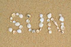 Sun. Word sun written on the sand with the shells Stock Photo