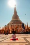 Sun worshipping at Shwedagon Pagoda Royalty Free Stock Photos