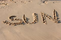 Sun written in sand Stock Photos