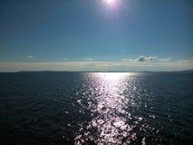 The Sun y el mar Fotografía de archivo