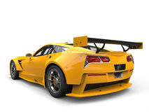 Sun yellow endurance race car - back view. Isolated on white background Stock Photography