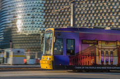 Sun in your Eyes. Adelaide city tram showing nice motion effect in front of samhri building Royalty Free Stock Photos