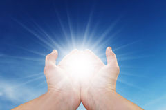 Sun In your hands Stock Image