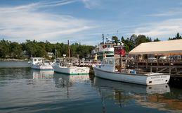 Sunapee Harbor. NH - CIRCA SEPTEMBER 2009 - Boats are docked in scenic , New Hampshire in September 2009. Sunapee is a charming harbor village featuring shops Stock Image