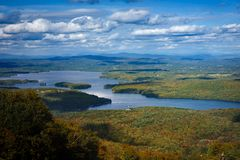 Sunapee lake from mount Sunapee as fall folliage is rising. Fall season is one of the most beautifull in new hampshire stock photo