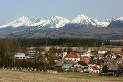 Sunava, Spis Region, Slovakia. Slovak village Sunava and snowy High Tatras mountains - Slovakia royalty free stock photo