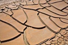 Sunbaked en gebarsten modder in Woestijnvallei, Nevada royalty-vrije stock foto's