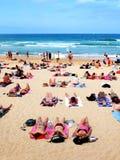 Sunbaking. People sun baking at the beach Royalty Free Stock Photo