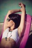 Sunbath at back yard. Young woman take sunbath at back yard sunny summer day Stock Images