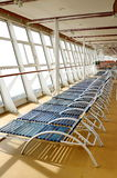 Sunbath chairs on cruise liner. Cruise ship open deck . Solarium. Relaxation area on upper deck of liner with sunbath chairs romantic summer vacation travel Royalty Free Stock Photo