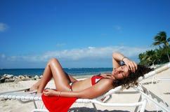 Sunbath In Grand Cayman. The girl having sunbath on Seven Mile Beach (Grand Cayman, Cayman Islands stock photos