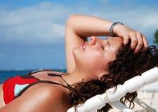 Sunbath On Grand Cayman. The girl having sunbath on Grand Cayman island beach, Cayman Islands royalty free stock images
