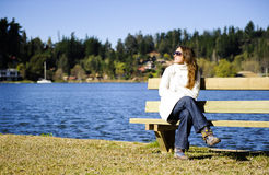 Sunbath at the lake. Shot in a beautiful blue lake in a cold morning with a lot of natural sunlight Stock Photo