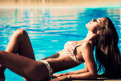 Sunbath by the pool Royalty Free Stock Images