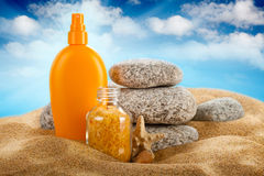 Sunbath - suntan oil and bath salt Stock Photography