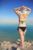 Sunbathe. Girl sunbathing on the beach with warm summer day Stock Image