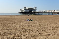 Sunbathe at Grand Pier, Weston-super-Mare. Royalty Free Stock Photo
