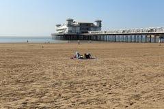 Sunbathe at Grand Pier, Weston-super-Mare. Royalty Free Stock Photo