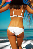 Sunbathed model girl in white lingerie behind blue beach ocean Stock Photography