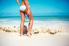 Sunbathed model girl in white lingerie behind blue beach ocean Royalty Free Stock Photos