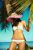Sunbathed model girl in white lingerie behind blue beach ocean Royalty Free Stock Images