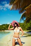 Sunbathed model girl in white lingerie behind blue beach ocean Stock Images