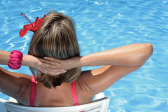 Sunbather in a Blue Pool Stock Photos