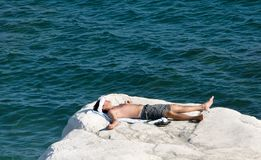 Sunbather young man. Young man to bask in on the beach in Cyprus Stock Photo