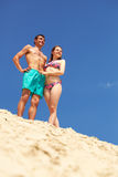 Sunbathers. Peaceful couple enjoying summer vacation on sandy beach stock images