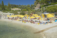 Sunbathers on beach on French Riviera, France Royalty Free Stock Photos