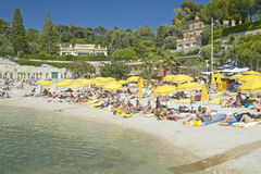 Sunbathers on beach on French Riviera, France Stock Images