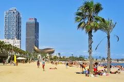 Sunbathers at La Barceloneta Beach, in Barcelona, Spain Royalty Free Stock Photography