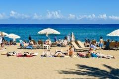 Sunbathers at La Barceloneta Beach, in Barcelona, Spain Royalty Free Stock Image