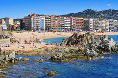 Sunbathers at Platja de Lloret beach in Lloret de Mar, Spain Stock Photo